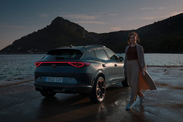woman standing next to the new cupra formentor suv with full led